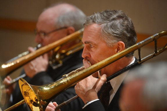"2013 - The OC Register's Classical Music Critic Tim Mangan dusts off his trombone to perform with conductor Carl St.Clair and the Pacific Symphony in ""OC Can You Play with Us?"" an initiative that allows amateurs to play side by side along with the pros at"