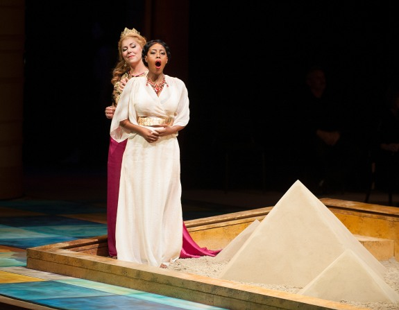 Amneris (Milena Kitic) and Aida (Kelebogile Besong) sing in th